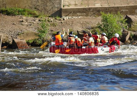 LOSEVO - AUGUST 18: Whitewater rafting on AUGUST 18 2012 RUSSIA. Unidentified persons enjoy whitewater rafting on the Vuoksi river in Losevo Leningrad region Russia