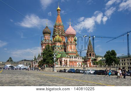 MOSCOW - JULY 02: View of Saint Basils Cathedral at the Red Square on July 02 2013 Moscow Russia. Red Square is central place and popular site in Moscow Russia