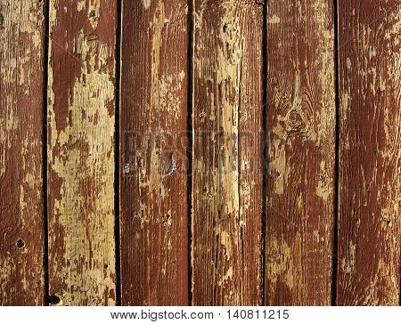 background of peeling paint on old wooden wall