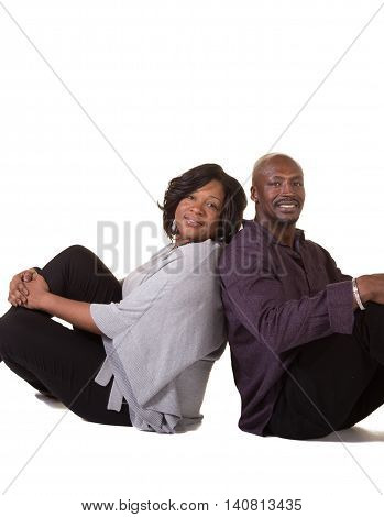Portrait of an older couple. Man has his head in the woman's lap, isolated