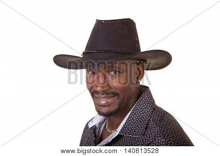 Middle aged man wearing a cowboy hat isolated on white