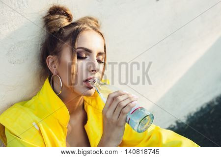 Beautiful Cheeky Girl Drinking Water In Park