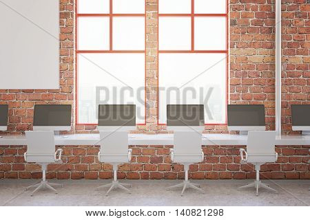 Red brick coworking office interior with blank computer monitors and blurry city view. Mock up 3D Rendering