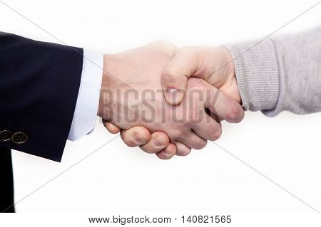 Multiracial handshake between african and a caucasian business man, isolated on white.