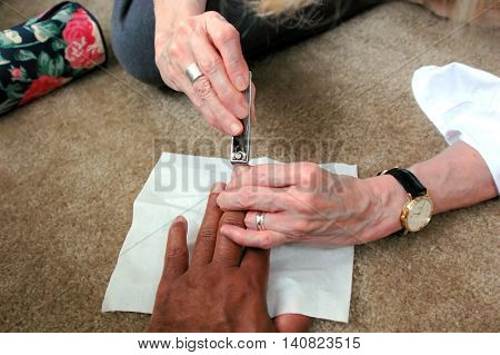 African american male getting a manicure at home.