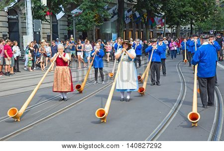 ZURICH - AUGUST 1: Swiss National Day parade on August 1, 2016 in Zurich, Switzerland. Musician in a historical costumes.