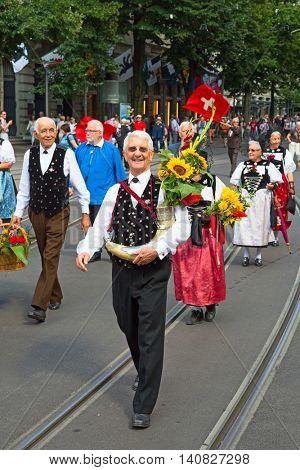 ZURICH - AUGUST 1: Swiss National Day parade on August 1, 2009 in Zurich, Switzerland. Representative of canton Appenzeller in a historical costume.