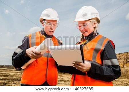 Man and woman working in an open-pit