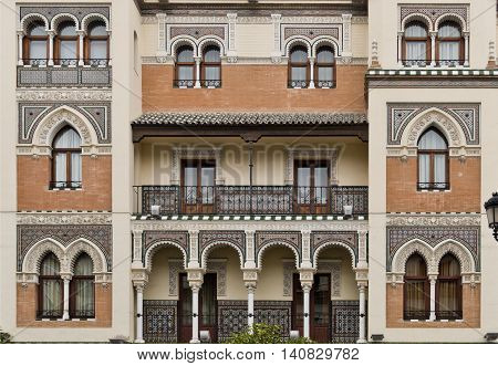 Detail of the marvellous neomudejar architecture with Moorish archs and ceramic tiles on a building in Seville Spain