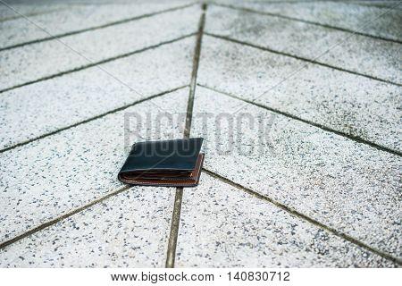 Lost wallet on the street, balck leather wallet