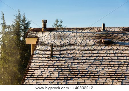 Morning sun on the frosted roof of a house