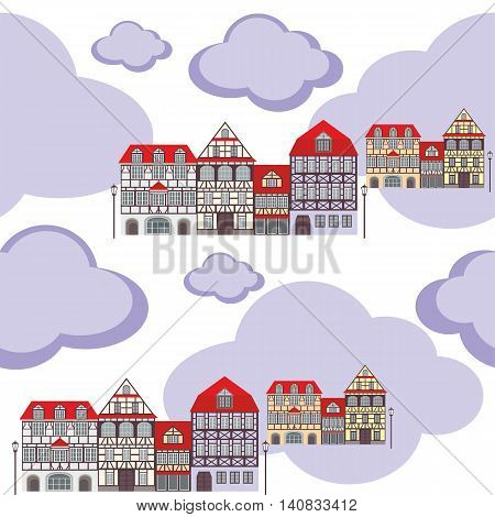 seamless pattern with the image of old town houses and clouds