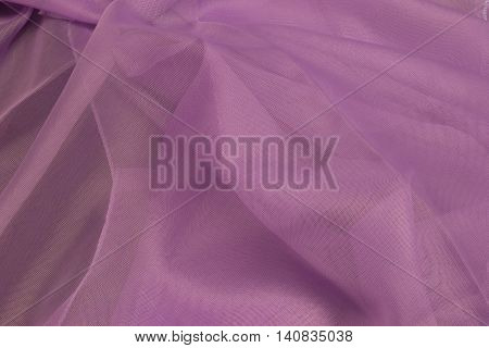 This is a photograph of Purple polyester fabric