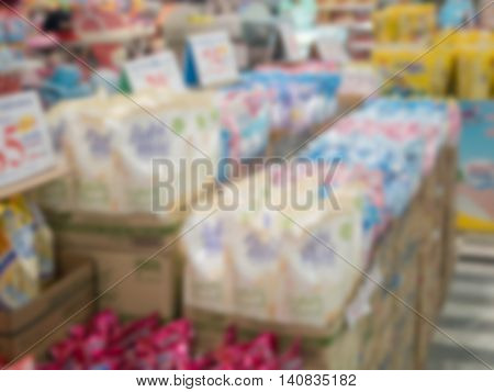 Blurred store shelves shampoo section at a supermarket