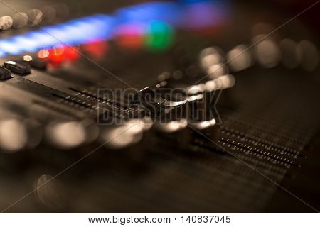 fader digital mixing console with volume meter volume indicator closeup poster