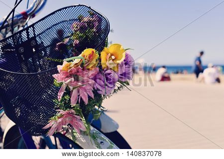 closeup of some bicycles ornamented with artificial flowers in the promenade of La Barceloneta beach, in Barcelona, Spain