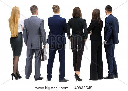 Business people from the back - looking at something over a whit