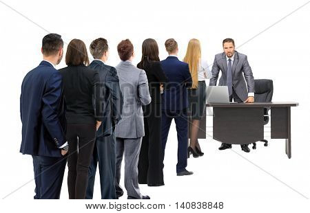 Business people looking at boss standing back side