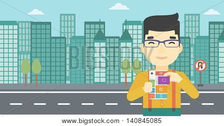 An asian man holding modular phone. Young man with modular phone on a city background. Man using modular phone. Vector flat design illustration. Horizontal layout.