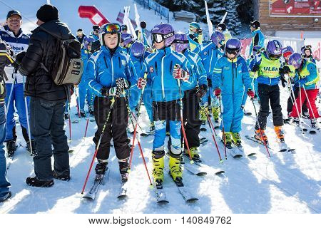 Bansko, Bulgaria - December, 12, 2015: Young skiers at opening new ski season 2015-2016 in Bansko resort, Bulgaria