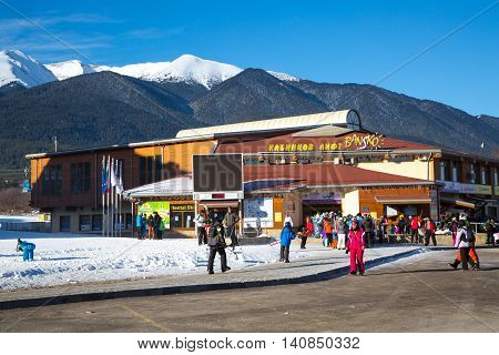 Bansko, Bulgaria - February 19, 2015: Bansko ski station, cable car lift and people near it in Bansko, Bulgaria
