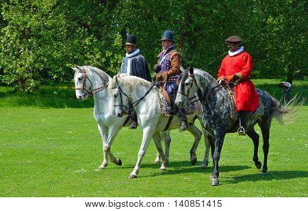 SAFFRON WALDEN, ESSEX, ENGLAND - JUNE 05, 2016: Three Grey horse  being  ridden by men wearing Elizabethan costumes.