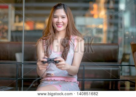 The Young Girl Playing Video Game