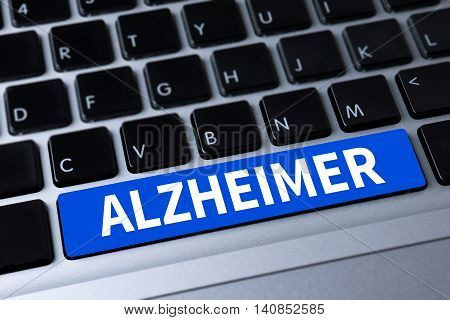 ALZHEIMER a message on keyboard man and hand computer