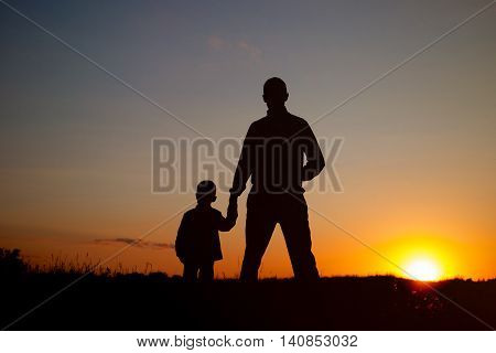 Father With Son In Sunset Time