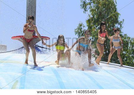 Rhodes Greece-July 16 2016:Group of children on the vet bubble.Vet bubble is very popular for young people in the Water Park.