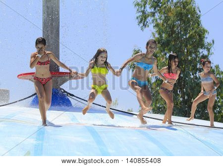 Rhodes Greece-July 16,2016:Group of children on the vet bubble.Mat racer slide is very popular for young people in the Water Park.Water  Park is located on the island of Rhodes in Greece and one of the most largest in Europe and is a very popular