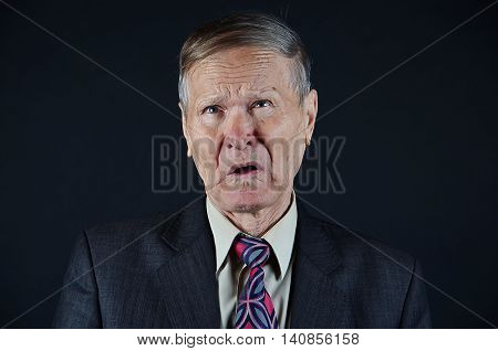 Businessman closeup portrait with hesitation on face, isolated black background, emotions, people concept