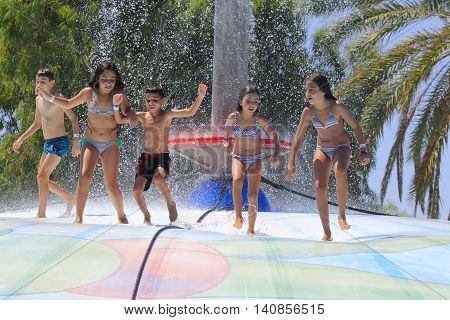 Rhodes Greece-July 16,2016:Group of children on the vet bubble.Mat racer slide is very popular for young people in the Water Park. Water Park is located on the island of Rhodes in Greece and one of the most largest in Europe