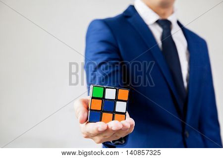 Bangkok, Thailand - July 28, 2016: Businessman Holding Rubik's Cube - Business Solving Problem And B