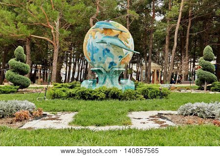 GELENDZHIK, RUSSIA - NOVEMBER 5, 2015: Sculpture World and Dolphins. Two dolphins on background of earth globe as architectural landscape element on November 5, 2015 in city-resort Gelendzhik, Russia