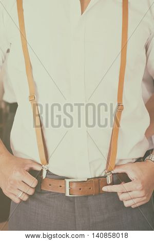 A Man wearing brown suspender film style retouching add grain.