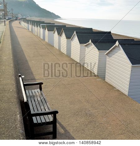 Row of wooden beach huts in Seaton, Devon