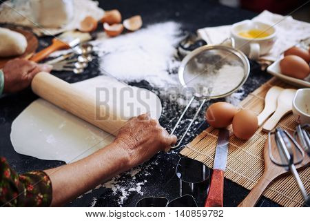 Hands of woman cooking pie at home