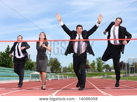 Businesspeople crossing the finish line