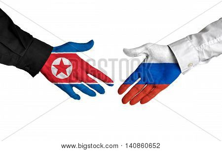 North Korea and Russia leaders shaking hands on a deal agreement
