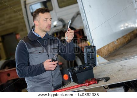 auto mechanic working on car at repair shop