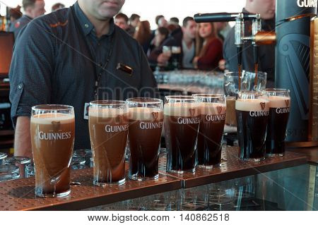 DUBLIN IRELAND - FEB 15 2014: Pints of beer are served at the popular Guinness Brewery on Feb 15 2014. The brewery where 2.5 million pints of stout are brewed daily was founded by Arthur Guinness in 1759.