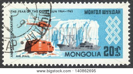 """MOSCOW RUSSIA - CIRCA APRIL 2016: a post stamp printed in MONGOLIA shows an Antarctic expedition the series """"International Quiet Sun Year"""" circa 1965"""