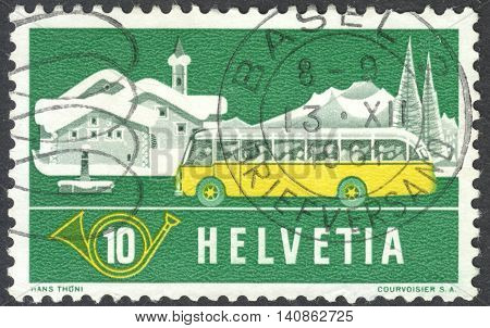 MOSCOW RUSSIA - CIRCA MAY 2016: a post stamp printed in SWITZERLAND shows an Alpine post bus and winter background the series