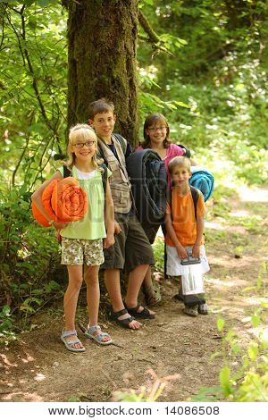 Group of kids with camping gear