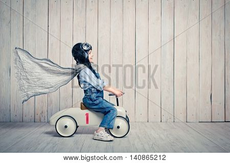 Little boy with a car in studio