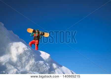Young woman with snowboard outdoors