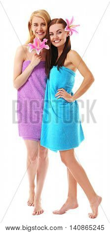 Two beautiful women wrapped in towel isolated on white