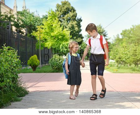 Brother taking sister to school