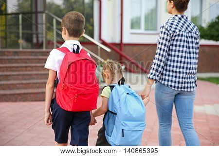 Mother taking children to school